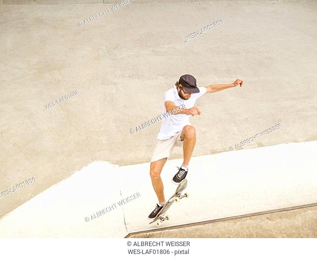 Young man skate boarding in skate park