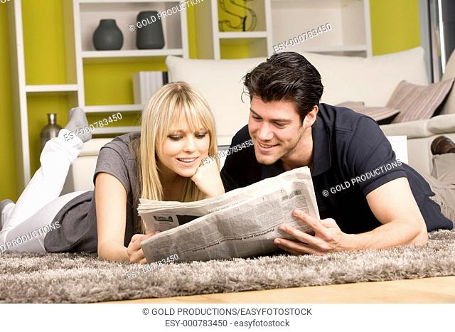 Couple with newspaper