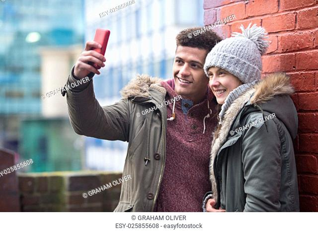 Young couple taking a selfie in the city