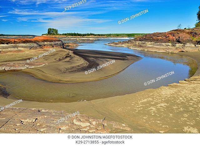 Slave River shoreline near the Mountain Rapids, near Fort Smith, Alberta, Canada