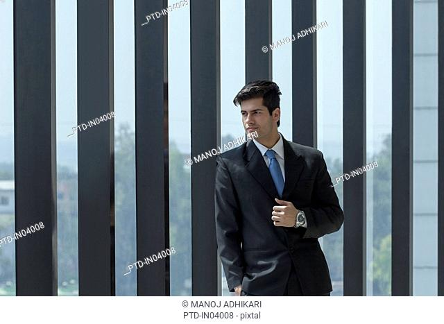 India, Man in suit standing outside building