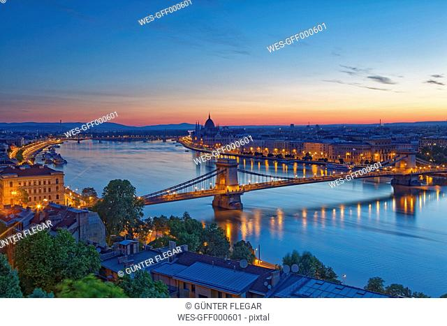 Hungary, Budapest, Danube river, Parliament Building and Chain Bridge, afterglow