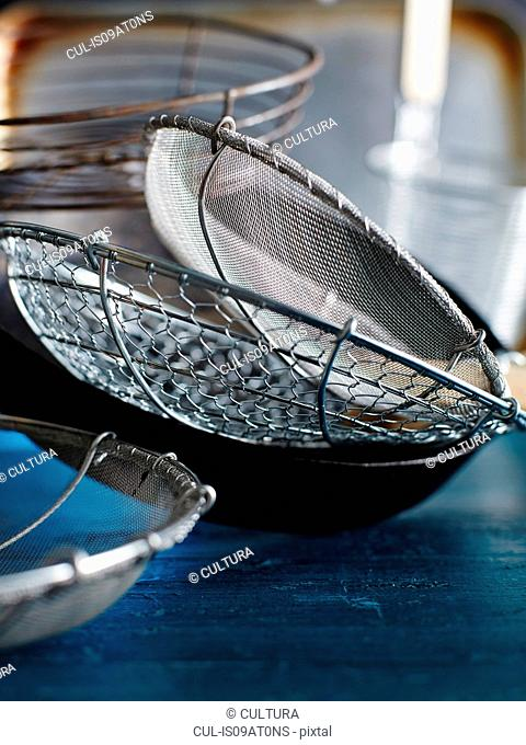 Metal sieves and strainers