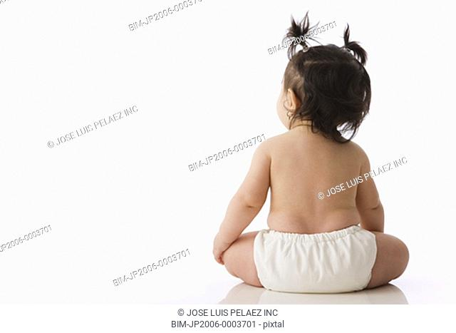 Rear view studio shot of baby with pony tails
