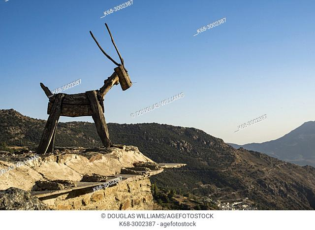 goat sculpture on a roof in the village of Capileira, Alpujarras, Andalucia, Spain