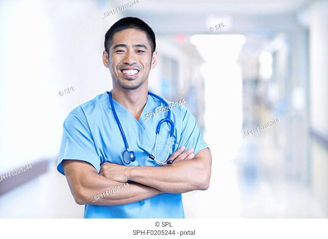 Male doctor smiling towards camera