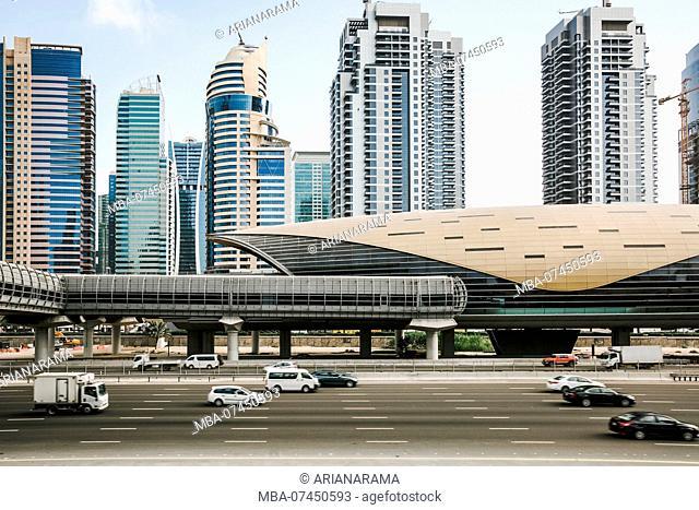 Futuristic building of Dubai metro station and highway in Dubai, United Arab Emirates