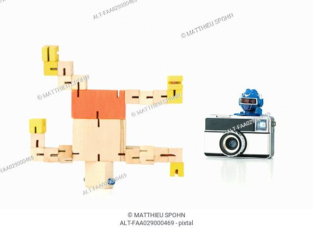 Robot taking photo of second robot breakdancing