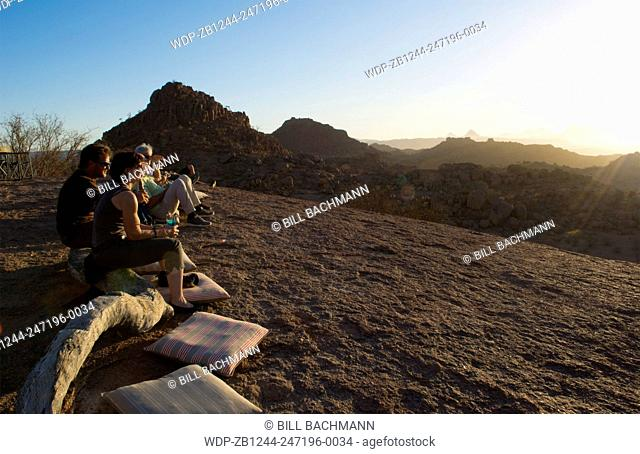 Namibia Africa sunset Sun Down drinks at Damaraland at resort called Mowani Mountain Camp with beautiful rock formations