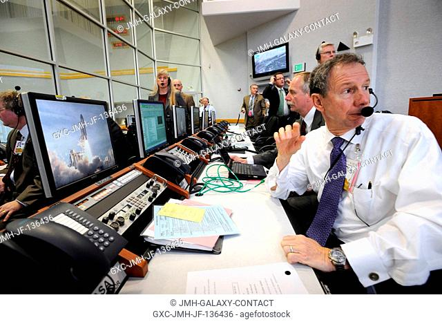 NASA Administrator Michael Griffin and other management watch the launch of the Space Shuttle Atlantis (STS-122) from the Launch Control Center Feb