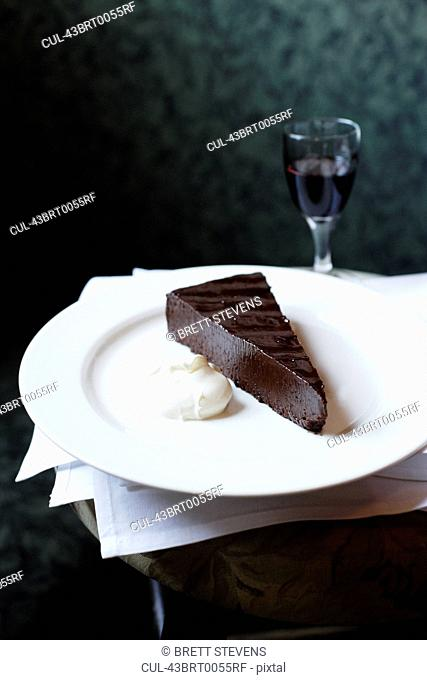 Plate of chocolate cake with whip cream