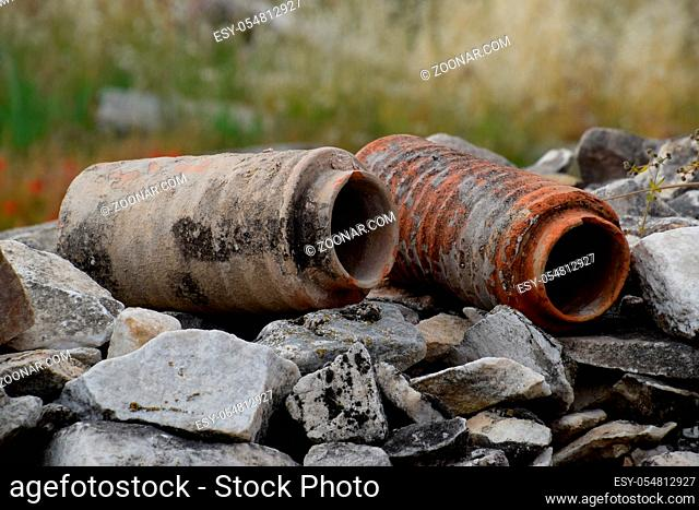 The remains of ancient ceramic pipes from the water supply. Prefabricated sections of ceramics from which the pipeline was assembled