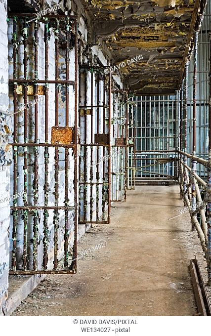 Cell block of the inside of an old prison no longer in use
