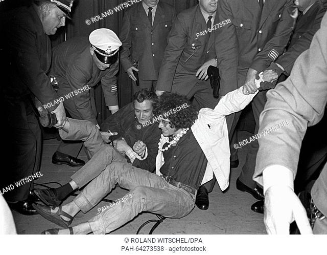 Demonstrators are pushed off stage by the police in the America House in Frankfurt on 06 September 1967. Members of the Socialist Student Union (SDS) tried to...