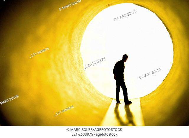 Silhouette of a man. Figurine of a man in a tunnel. Toy, miniature man