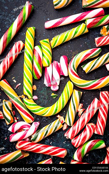 High angle view of a broken candy cane on dark background