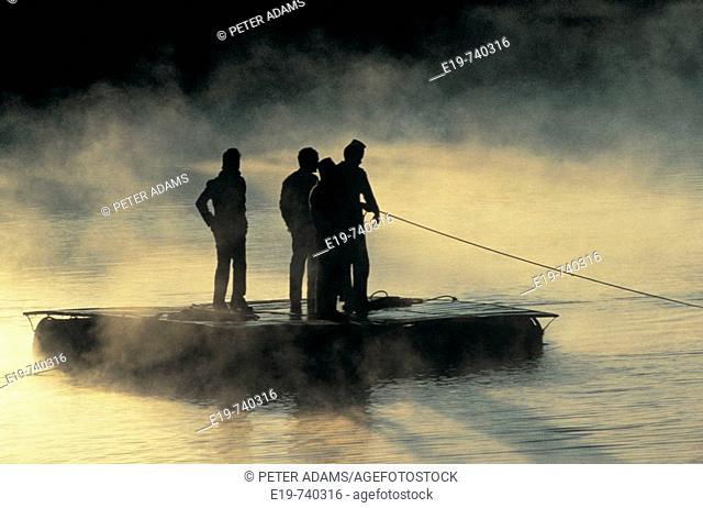 Raft on misty river, Pokhara, Nepal