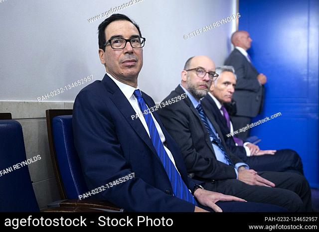 United States Secretary of the Treasury Steven T. Mnuchin listens during a news conference in the James S. Brady Press Briefing Room at the White House in...