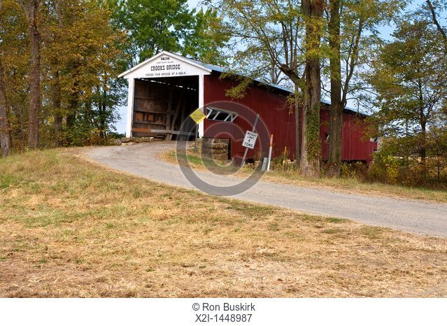 Crooks Covered Bridge, circa 1860,spans Molasses Creek in Parke County, Indiana, USA