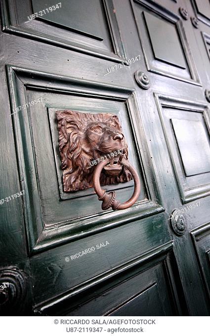 Old Brass Door Knocker with Figure