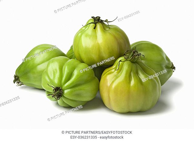 Heap of green Coeur de boeuf tomatoes on white background