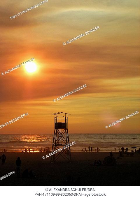 The sun sets above Cannon Beach, US, 3 September 2017. Cannon Beach is a small town in Clatsop County, Oregon, and is a favourite tourist destination in the...