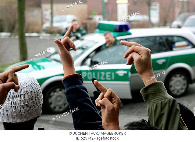 DEU, Germany : juvenile crime. Young man is arrested by the police. Young boys protesting against the police.(posed scene)