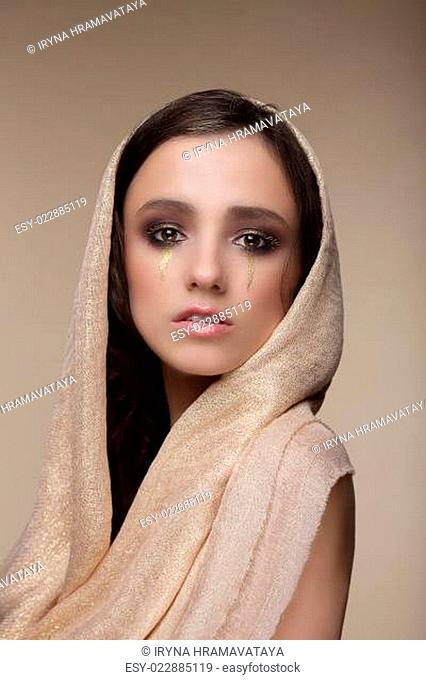 Stylization. Woman with Golden Tears. Art Makeup