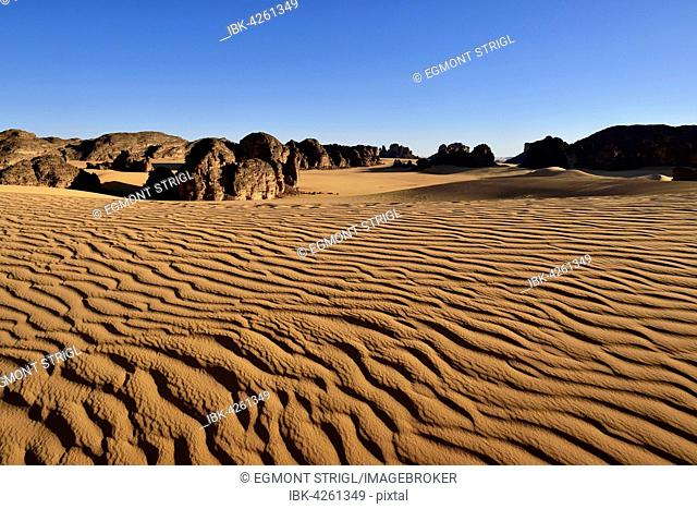 Sanddunes and rock towers in Tassili n' Ajjer National Park, Sahara desert, Algeria