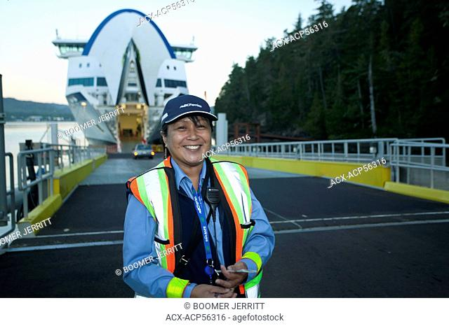 A First Nations BC Ferry employee aboard the MV Northern Explorer in Port Hardy, Vancouver Island, British Columbia, Canada