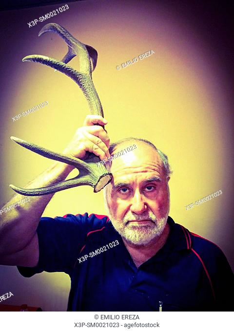 Old man with a horn