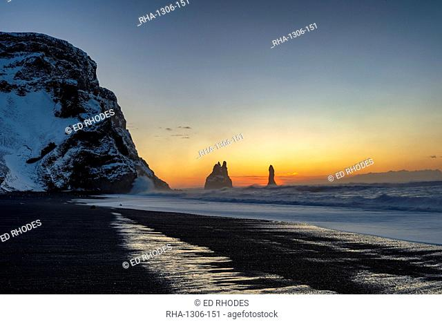 Rock stacks of Reynisdrangar at sunrise, from Halsanefs Hellir Beach near Vik, South Iceland, Iceland, Polar Regions
