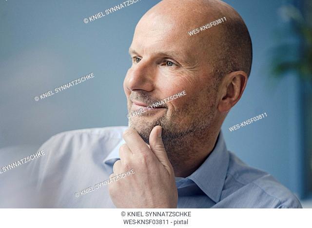 Portrait of smiling mature businessman looking sideways