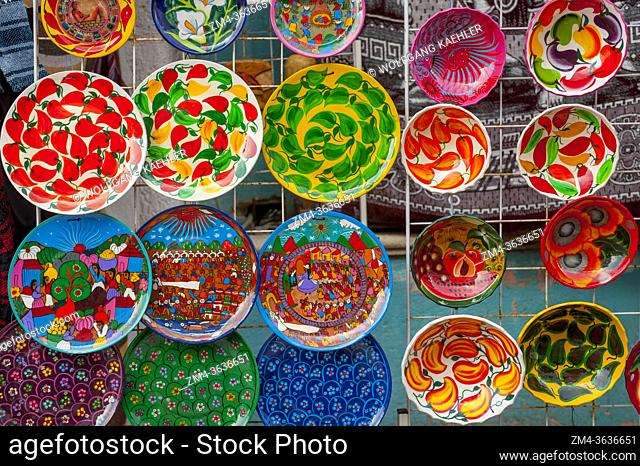 Street scene with colorful souvenir plates for sale at a store on 5th Avenue in Playa del Carmen on the Riviera Maya near Cancun in the state of Quintana Roo