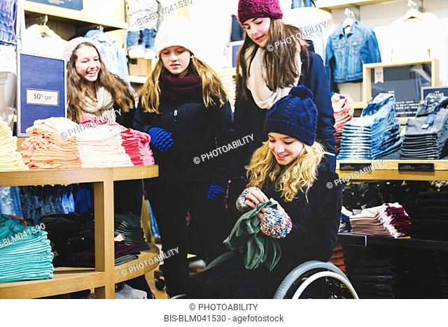 Girls shopping in clothing store
