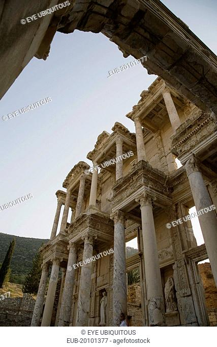Ephesus. Part view of ornately carved marble facade and archway in antique city of Ephesus on the Aegean sea coast