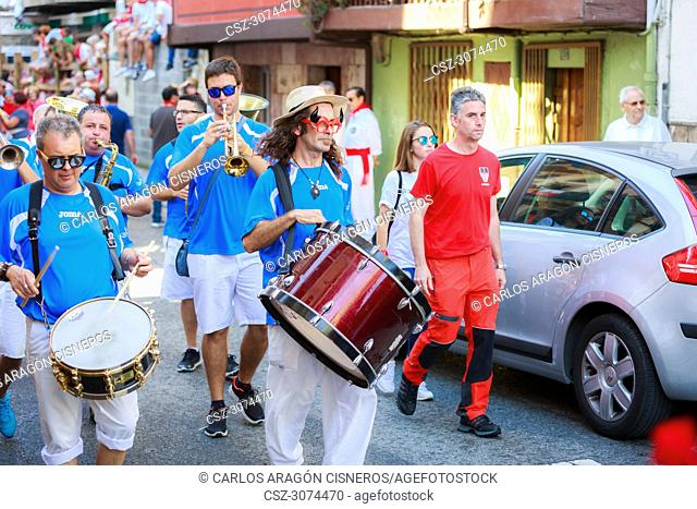 AMPUERO, SPAIN - SEPTEMBER 10: Unidentified group of musicians with a saxophone before the Bull Run on the street during festival in Ampuero