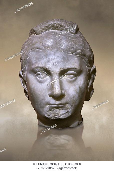 Roman statue head of a woman. Marble. Perge. 2nd century AD. Inv no 1016. Antalya Archaeology Museum; Turkey. Against a warm art background