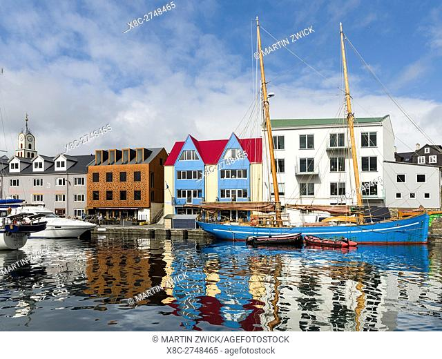 Peninsula Tinganes with old town, government district and the western harbour. Torshavn (Thorshavn) the capital of the Faroe Islands on the island of Streymoy...