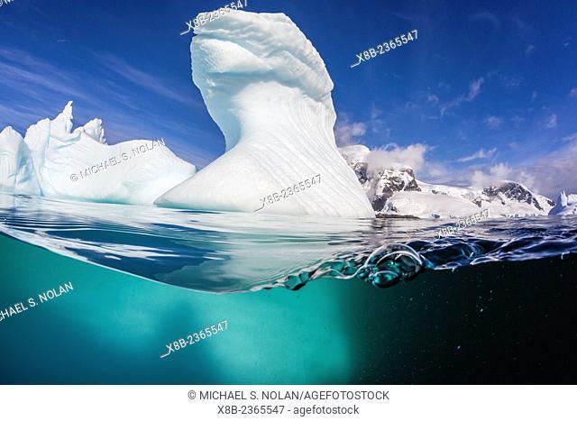 Iceberg detail above and below water at Danco Island, Errera Channel, Western side of the Antarctic Peninsula, Antarctica