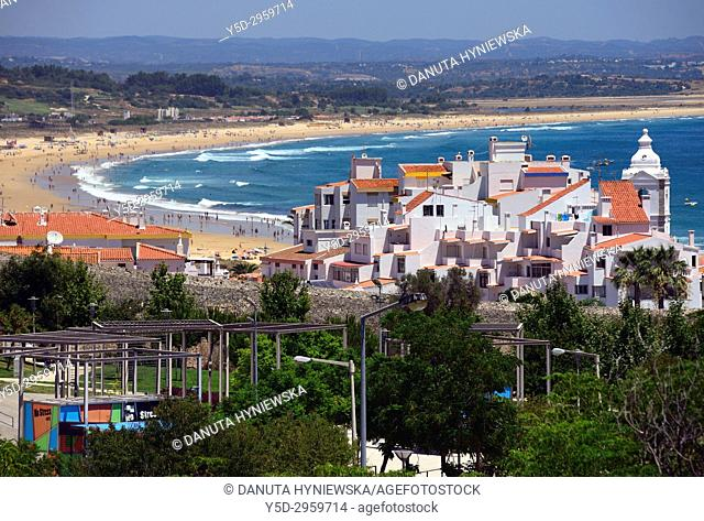 view for the old town of Lagos city, city walls, tower of Santo Antonio church, in far background long Meia Praia and Monchique mountains, Algarve, Portugal