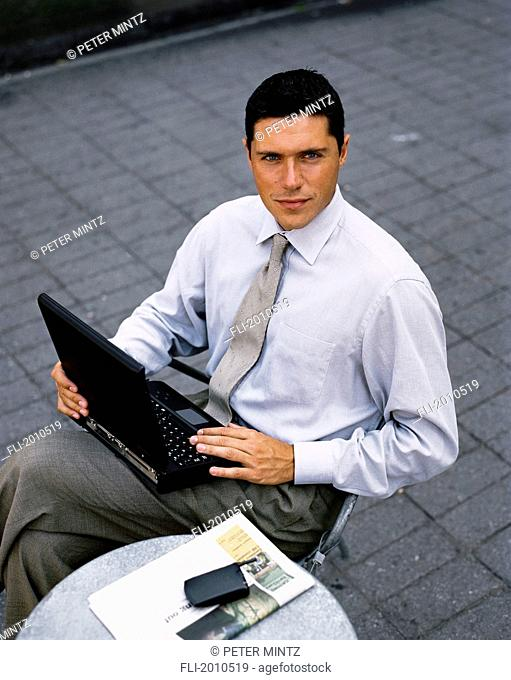 Fv4013, Peter Mintz; Businessman With Laptop Looking Up