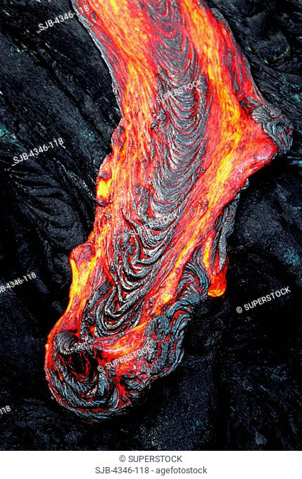 A Stream of Glowing Hot Pahoehoe Lava Oozing Over a Ledge