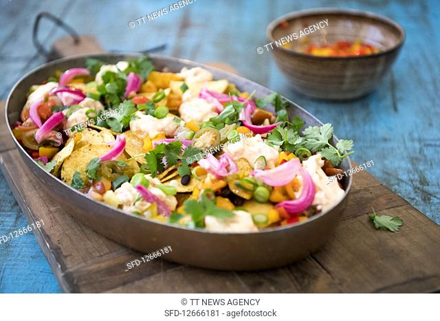 Vegeterian Nachos with vegetables cheddar kimchi and majo