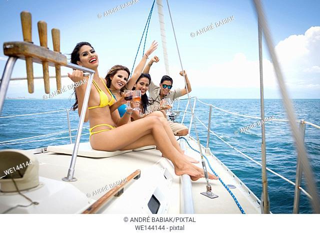 Group of young people enjoying a sailboat tour, Riviera Nayarit, Mexico