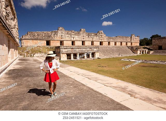 Tourist a the Quadrangle Of The Nuns in Uxmal Ruins, Uxmal, Yucatan Province, Mexico, Central America