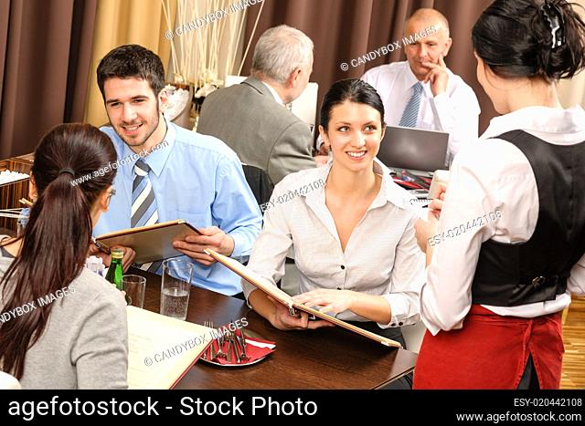 Business lunch waitress take order meal restaurant