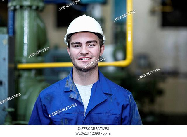 Portrait of confident worker in factory
