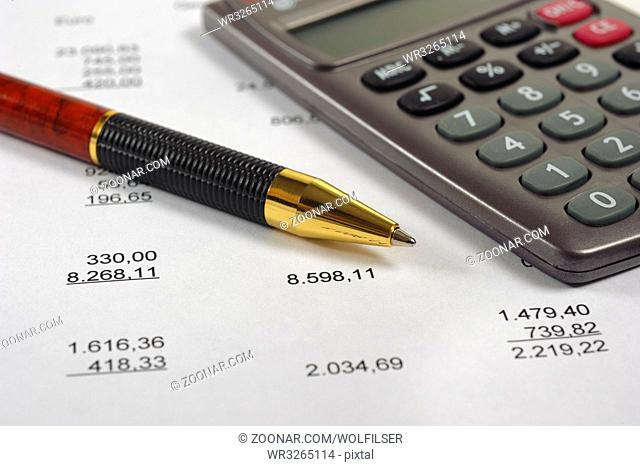 financial accounting with table sheet and calculator