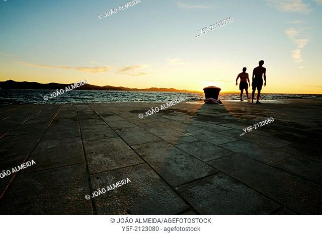 Boys playing football close to the Adriatic sea at Zadar